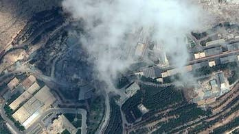Satellite imagery appears to show flattened structures; Mike Tobin reports from Jerusalem.