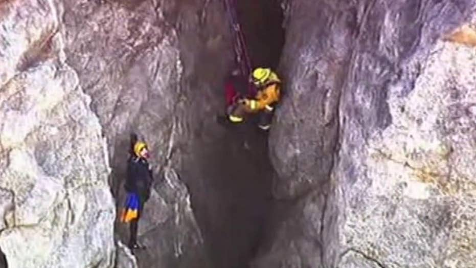 Firefighters rescue man after his car plunges off cliff