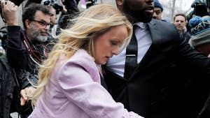 Raw video: Former adult film star Stormy Daniels is escorted into New York City courthouse ahead of hearing for President Trump's personal attorney who seeks to be allowed to decide which items seized by the FBI are protected by attorney-client privilege.