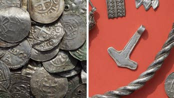 A treasure trove has been uncovered in the eastern German island of Ruegen in the Baltic Sea. The find includes Hundreds of 1,000-year-old silver coins and jewelry. One of the rare jewels depict 'Thor's hammer.'