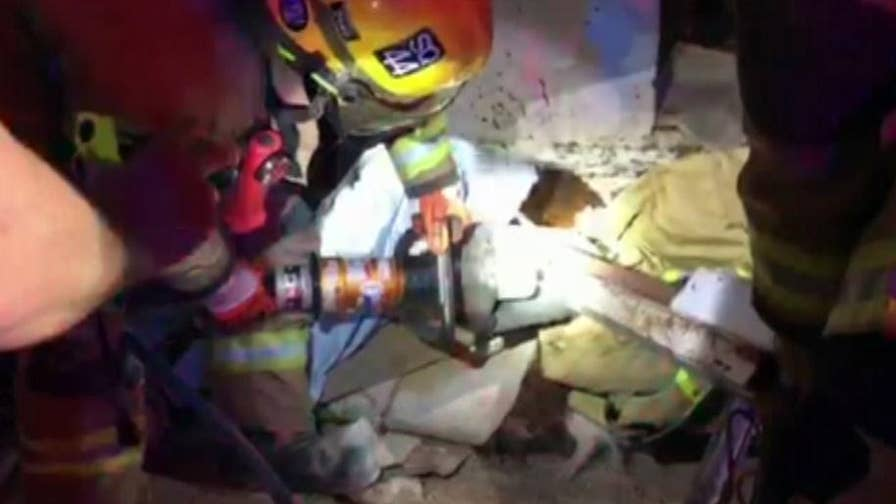 Raw video: Phoenix Fire Department crews, veterinarian rescue horse trapped upside down in an abandoned trailer.
