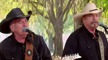 Country music duo releases autobiography.