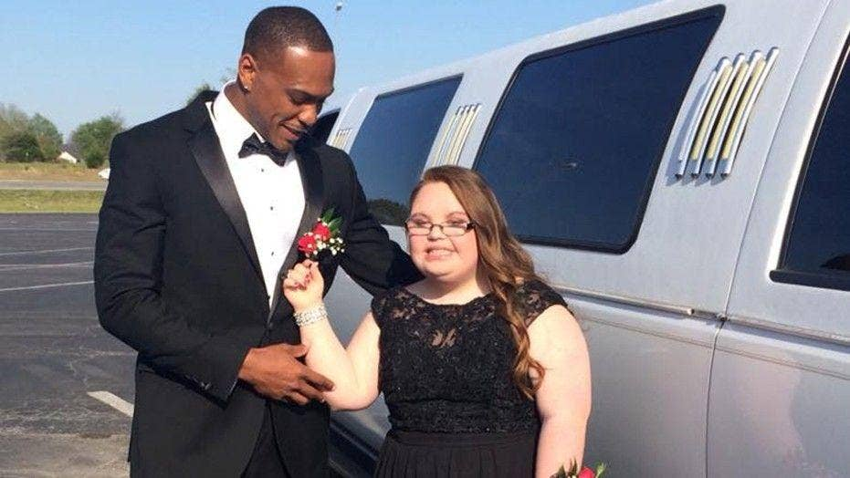 NFL star takes fan with Down syndrome to her high school prom