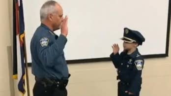 Raw video: Four-year-old boy battling stage 4 cancer for second time has dream of becoming police officer come true after Colorado Springs Police Department makes him one of their own.