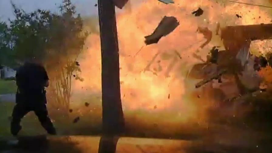 Officer's dash cam captures the moment a Texas home explodes after being struck by a car.