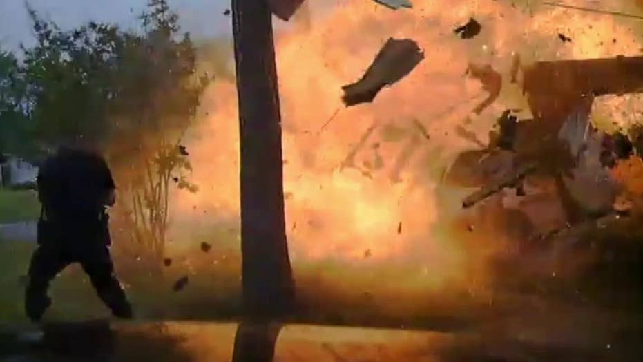 Raw dash cam footage captures house explosion
