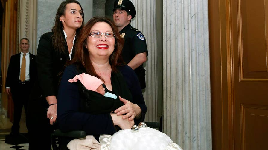 Senator Tammy Duckworth makes history by casting a vote with her newborn daughter.