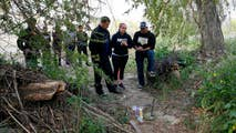 Raw video: Police claim California teen who led search party to body of his friend was the one who stabbed him and dumped his body near a riverbed.