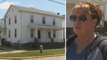 Ohio woman stops after seeing toddler dangling off the roof and catches the child before they hit the ground.