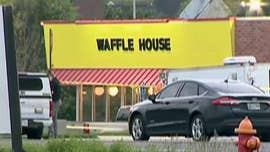 "Authorities launched a dragnet for a shooter who gunned down at least four people and injured several others at a Tennessee Waffle House early Sunday before a ""hero"" patron wrestled the weapon away, police said."