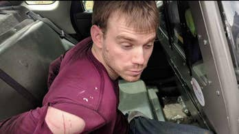 Police release image of Travis Reinking following his capture and arrest. Reinking is accused of gunning down four people at a Waffle House restaurant in Tennessee; Jonathan Serrie reports.