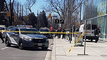 Toronto police say the driver is in custody after his van plowed into pedestrians.