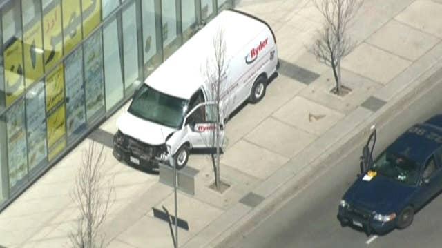 Police: Van jumps curb, strikes pedestrians in Toronto