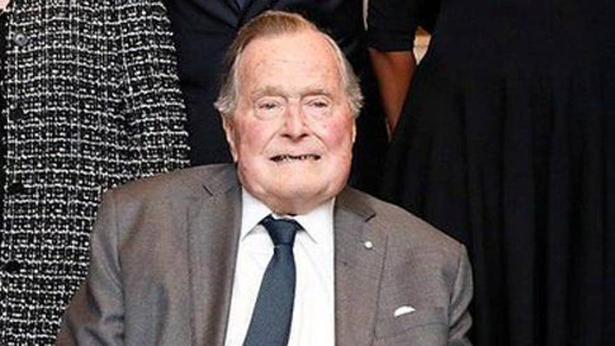 A spokesperson for the family says Bush contracted an infection that spread to his blood, is 'responding well' to treatment.