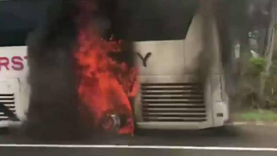 Dr. Oz aids students after bus bursts into flames