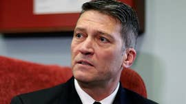 "Dr. Ronny Jackson, President Trump's pick to run the Department of Veterans Affairs, previously exhibited ""unprofessional behaviors"" amid a power struggle over the White House medical unit, according to a 2012 report by the Navy's Medical Inspector General."