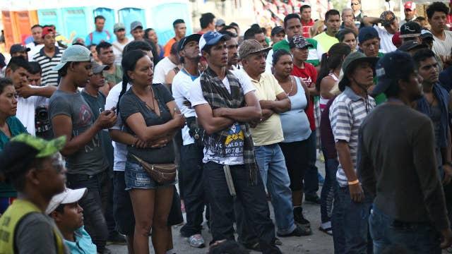 Migrants sneak across US border, prepare asylum claims