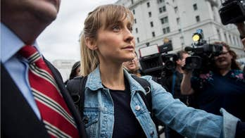 """""""Smallville"""" star Allison Mack faces 15 years to life in prison If she is convicted for conspiracy to commit forced labor and sex trafficking. She was released from federal custody on $5 million dollars bail."""