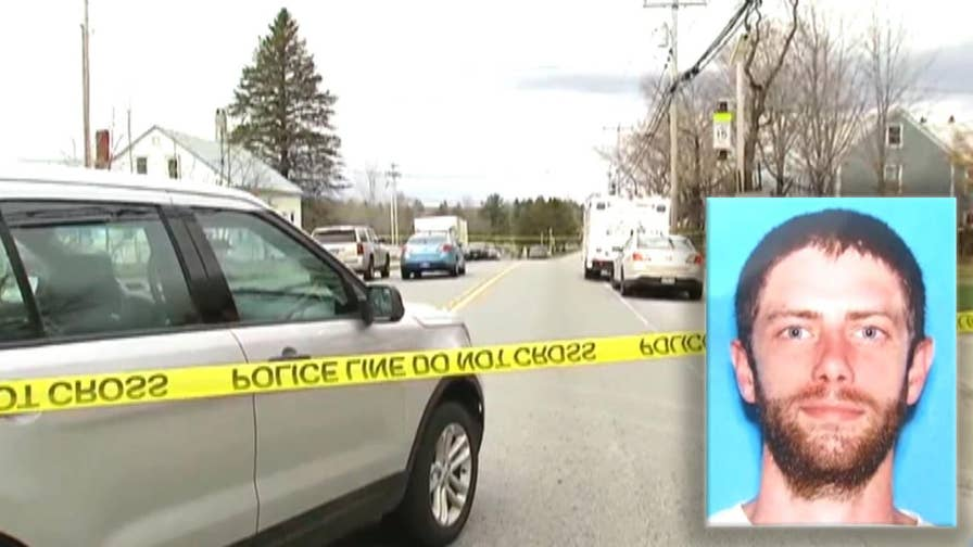 Manhunt under way after sheriff's deputy killed in Maine. Suspect is considered armed and dangerous.
