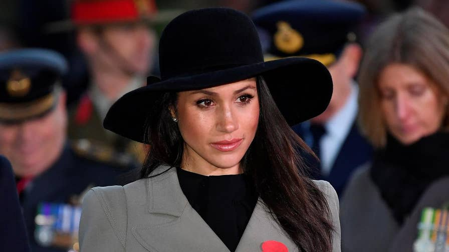 Meghan Markle opted for a decidedly more conservative look at a dawn Anzac Day memorial service alongside her fiancé, Prince Harry, two days after being chastised on social media for wearing an inappropriate outfit to a memorial service for a murder victim.