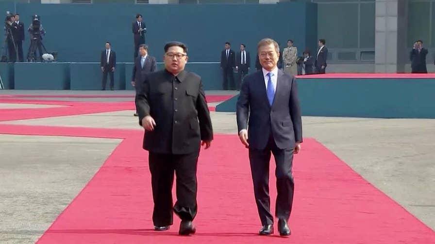 North Korean leader crosses DMZ line in effort to reduce hostility
