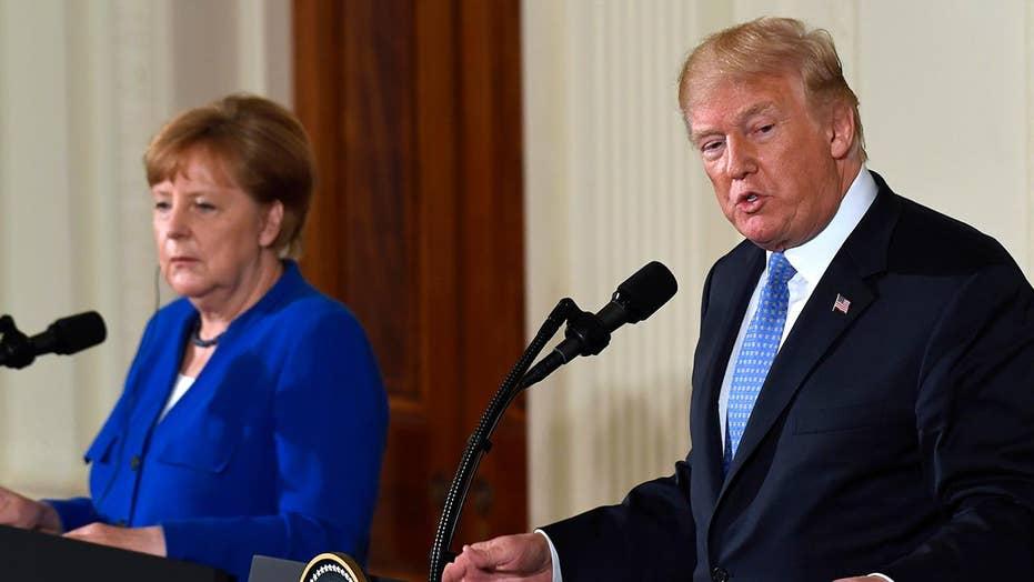 Trump hosts Merkel as North and South Korean leaders meet