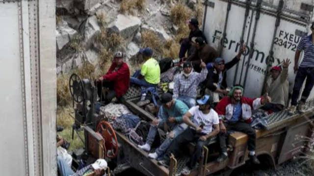 Migrant caravan prepares to cross into the United States