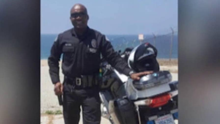 Officer Mambasse Koulabalo Patara was caught at a border checkpoint trying to smuggle two illegal immigrants into America.