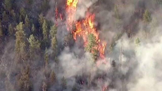 Arizona wildfires force hundreds to evacuate homes