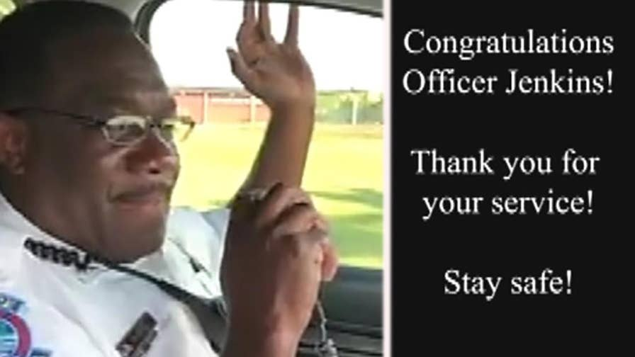 Officer Andre Jenkins fights back tears as he signs off for the last time