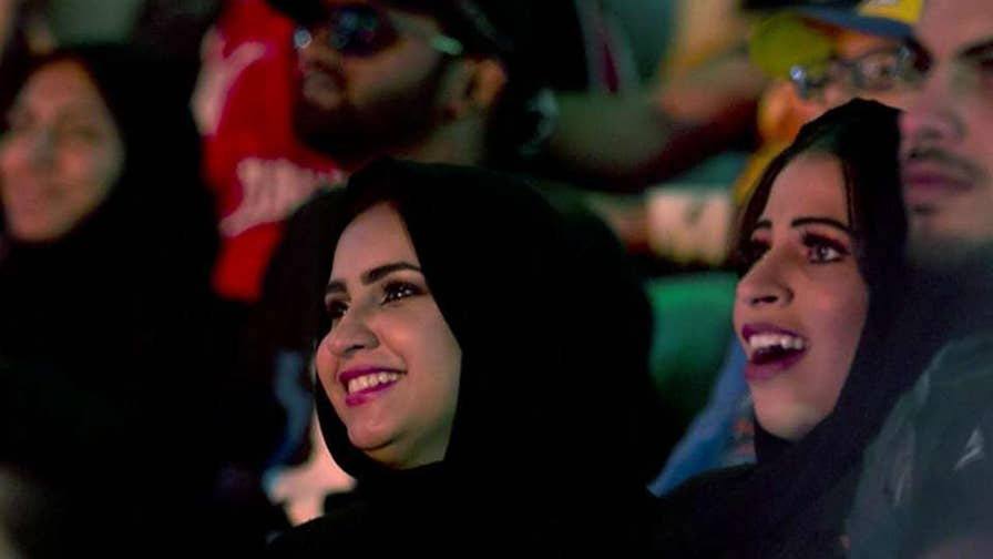 Officials in Saudi Arabia apologize after images of women wrestlers in skimpy outfits appeared onscreen during a wrestling match.
