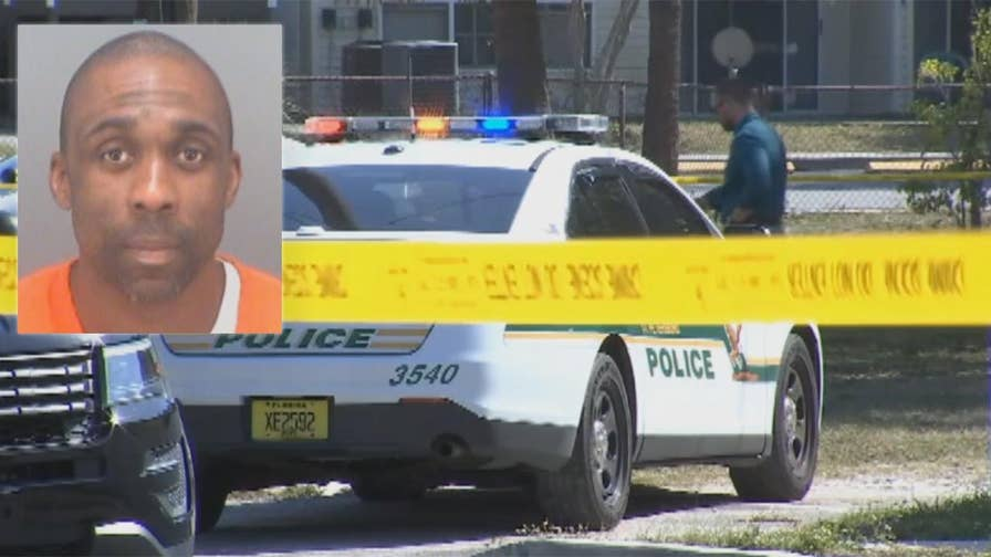 St. Petersburg police take man into custody after he allegedly showed the body of a dead woman to his neighbors.