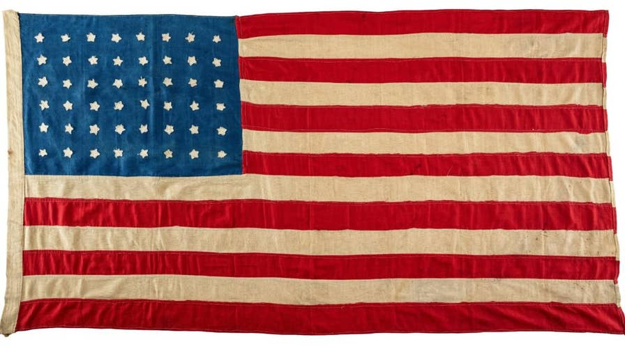 A 100-year-old flag used in the funeral of U.S. troops on a small Scottish island during World War I is making it back to where it originated from as part of a remembrance of the Great War.