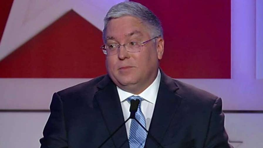 West Virginia Attorney General Patrick Morrisey rejects Evan Jenkins' claim that he helped flood West Virginia with opioid pain pills.