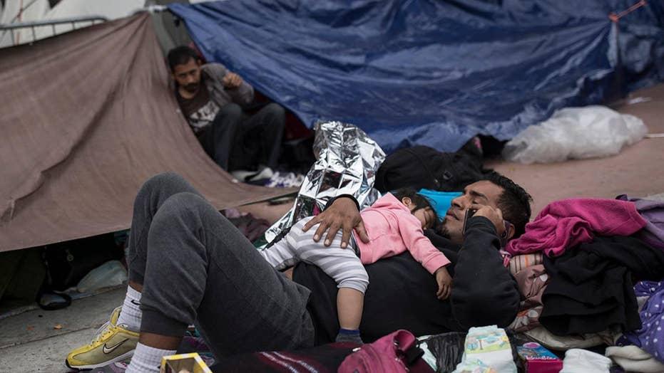 Some members of migrant caravan allowed to apply for asylum