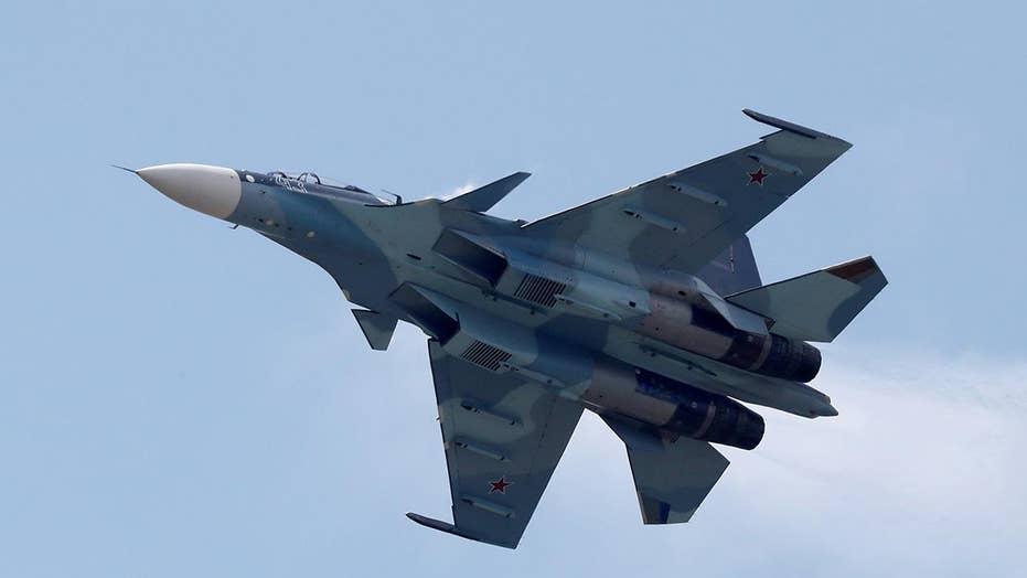 Russian fighter jet buzzes US spy plane