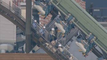 Riders on a Universal Studios Japan roller coaster were stranded for hours 'mid-flight' when the coaster malfunctioned.