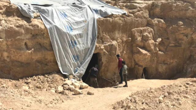 Archeologists find 'refuge cave' in former Isis territory