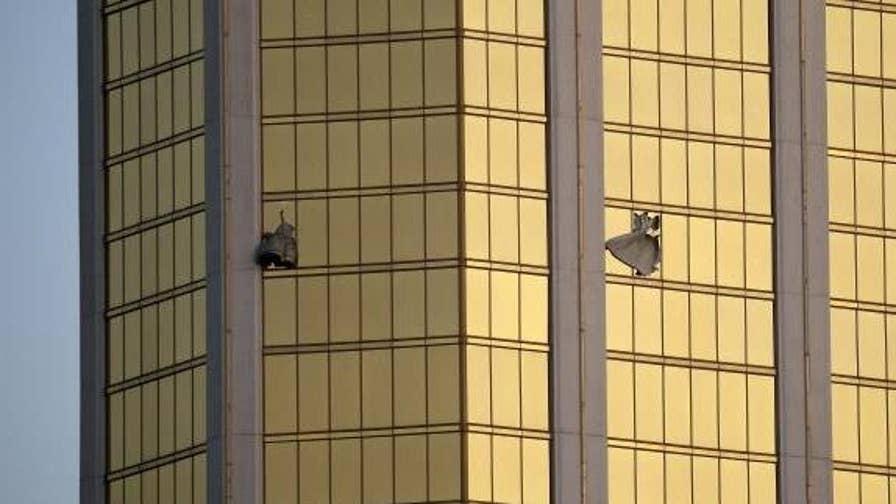 Raw video: Las Vegas police video shows officers searching gunman Stephen Paddock's Mandalay Bay suite.