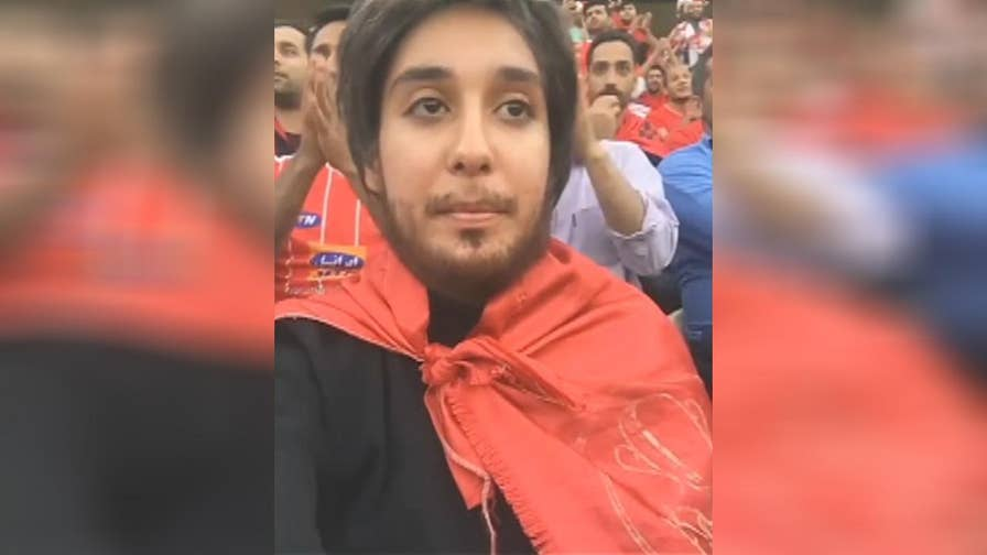 Raw video: Woman in Iran wears fake facial hair and dresses as a man in order to watch a soccer match from inside the Azadi Stadium in Tehran, where women spectators are forbidden by law.