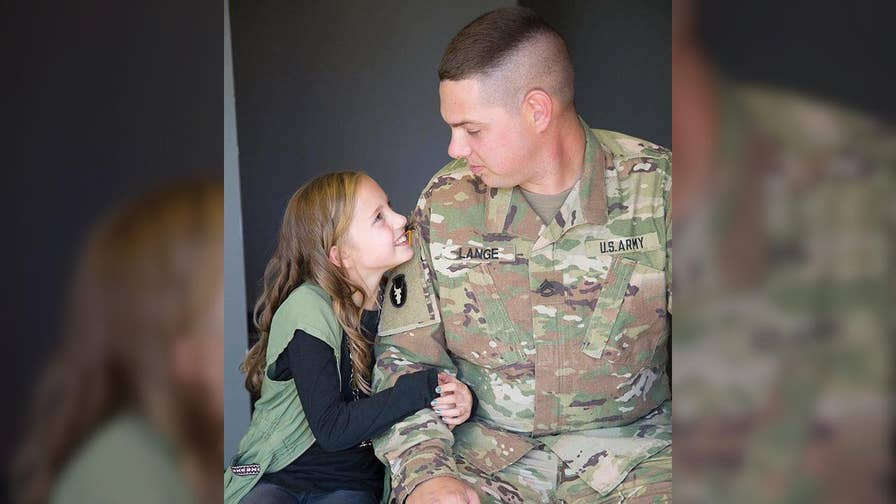 Ahead of her cheerleading squad's national competition, Mikayla Lange was surprised with a very special good luck message from her father, Sgt. First Class Robert Lange, from halfway across the world.