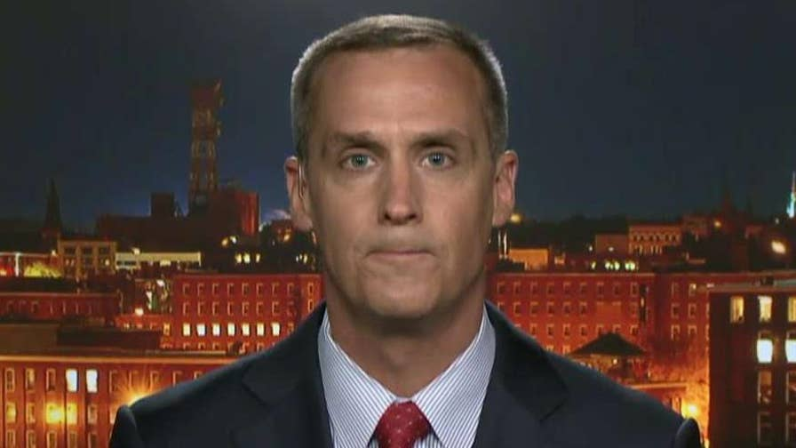 Corey Lewandowski takes legal action against reporter who admitted to entering his home without permission.