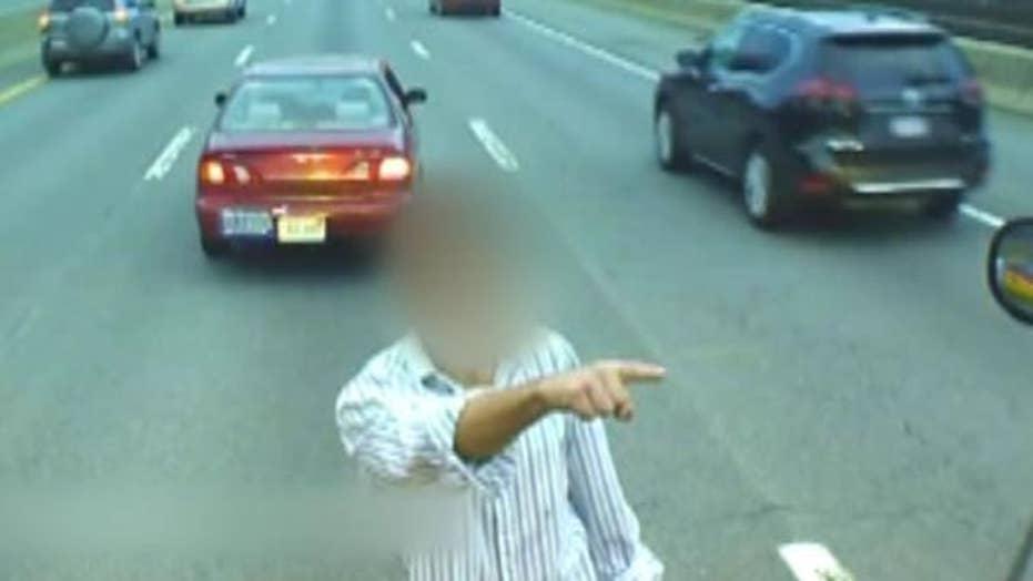 Man parks car on Massachusetts Turnpike, climbs onto bus