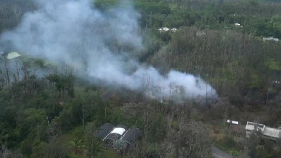 Lava and gas spurt from volcanic vents in Hawaii