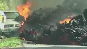 Molten rock flows into Leilani subdivision; William La Jeunesse reports from Hawaii.