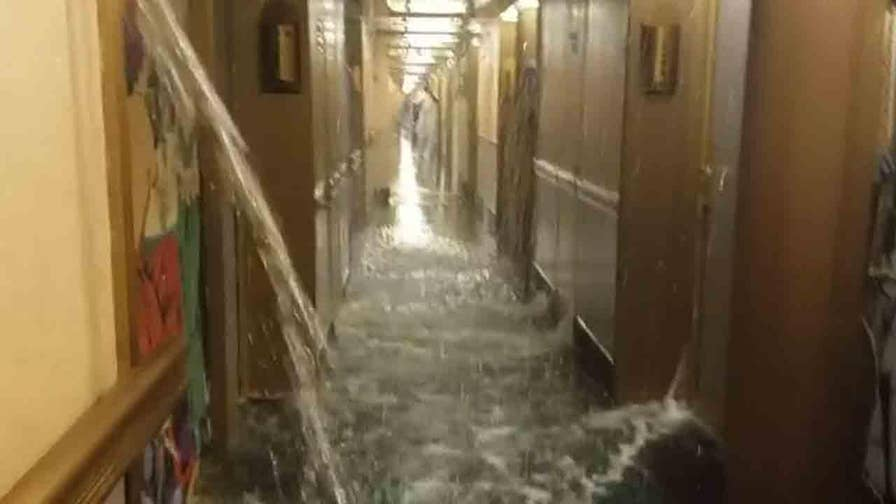 Officials blame a leak in the Carnival Dream's fire suppression system for incident that occurred five days into a week-long voyage around the Western Caribbean.