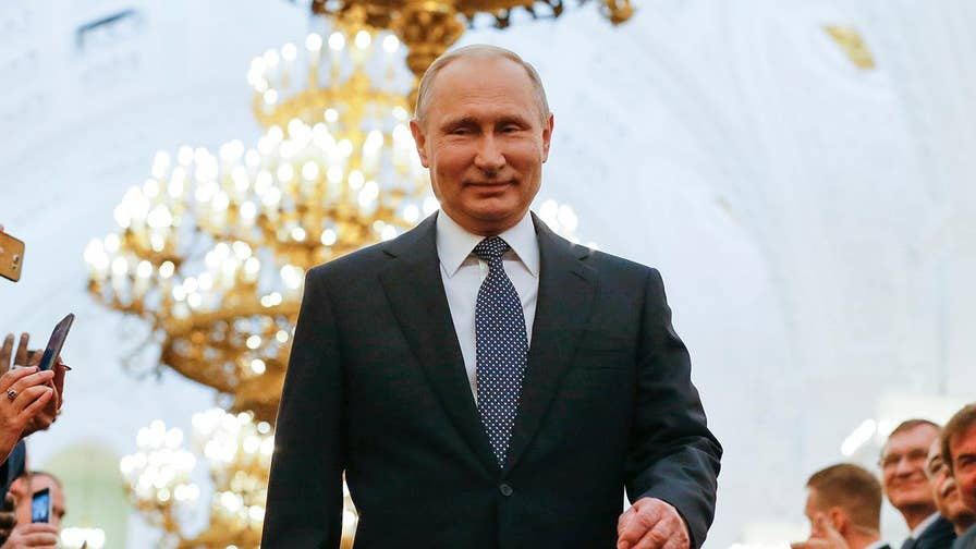 Vladimir Putin takes oath of office in Kremlin, pledging to pursue policies that would improve the economy and boost living standards.