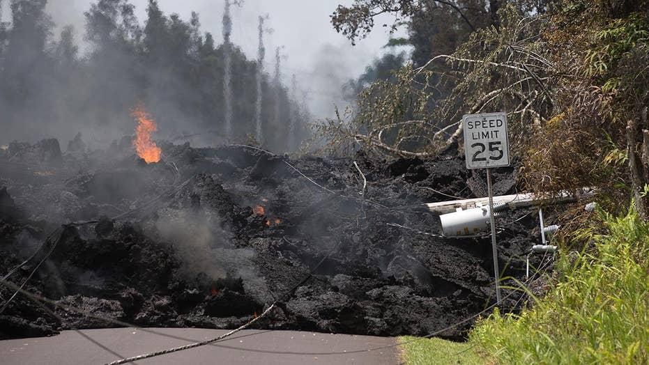 Hawaii volcano lays waste to dozens of homes