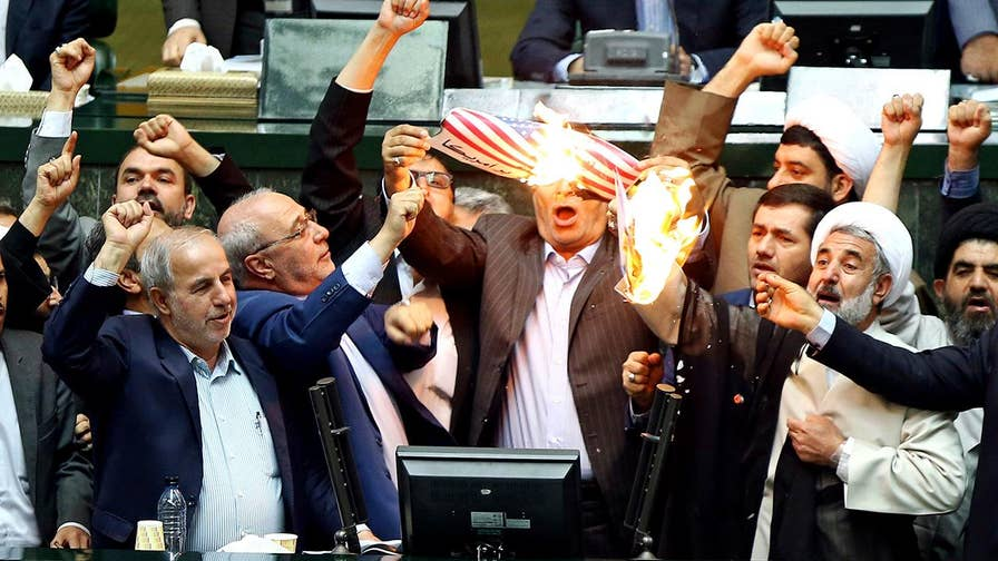 American flag burned in Iranian parliament after President Trump pulls out of the Iran nuclear deal.