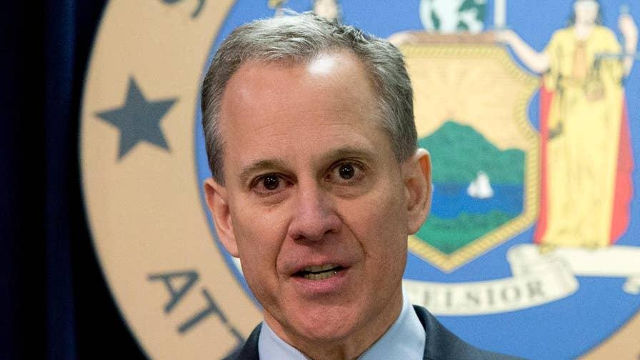 Former New York attorney general steps down, denies assault allegations.